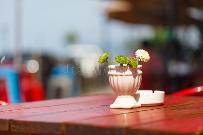 Flowers in vase on the street cafe stock photo