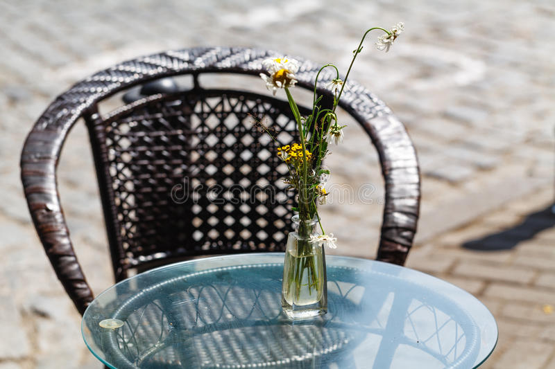 Flowers in vase on the street cafe stock photography