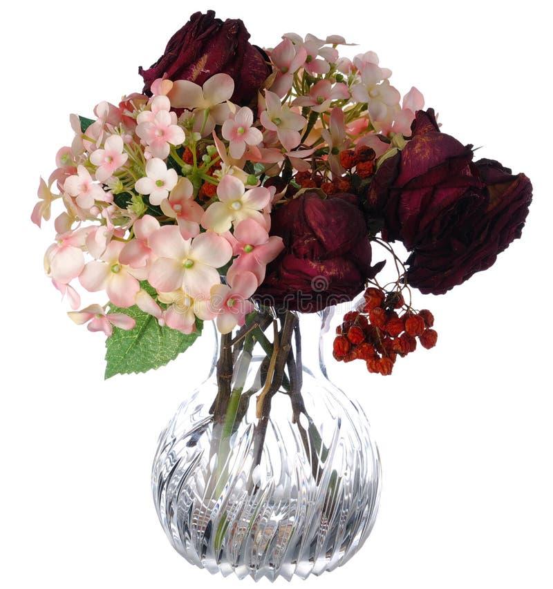 Flowers in vase on white