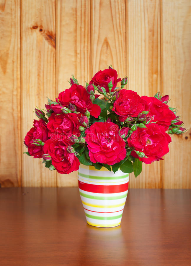 Flowers in a vase on wooden table old royalty free stock photos
