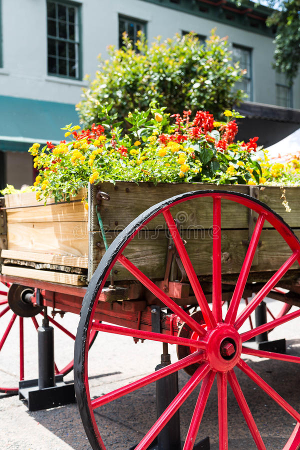 Flowers in Wagon Over Red Wheel stock photo