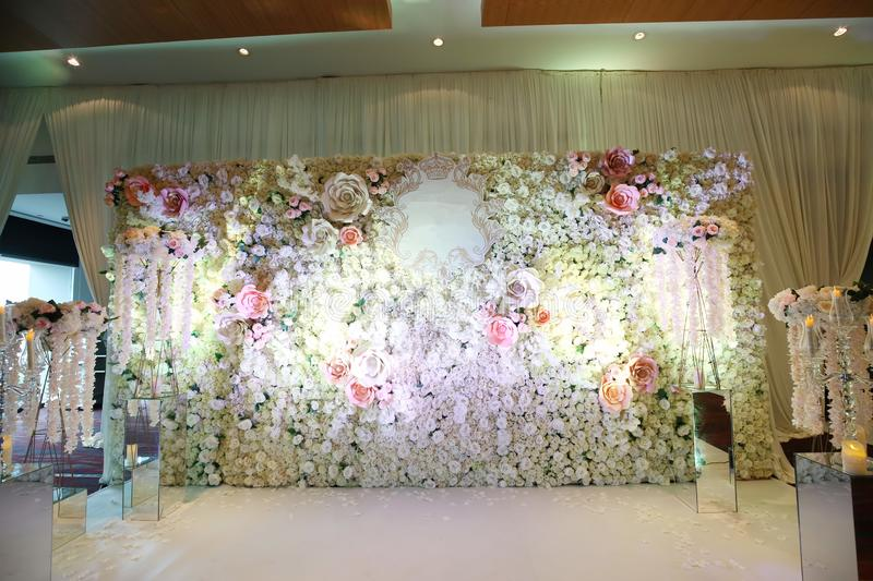 Wedding reception. Flowers wall background with amazing red and white roses, Wedding decoration, hand made royalty free stock photo