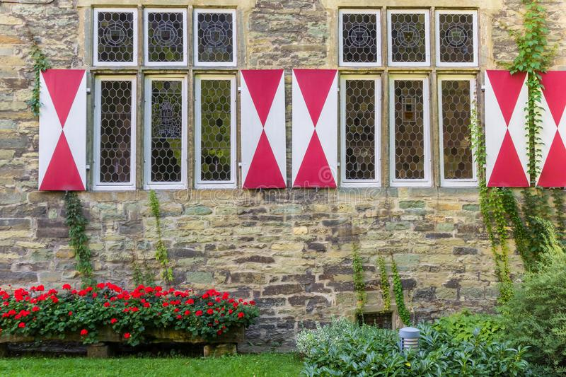 Flowers and windows of the Burghof museum in Soest stock photography