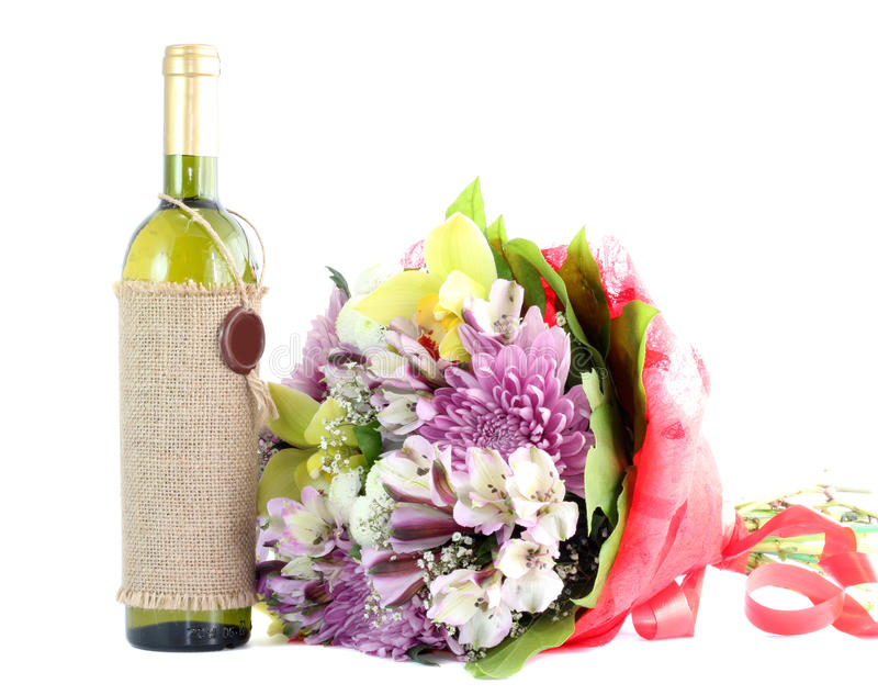 Flowers and wine isolated. stock images
