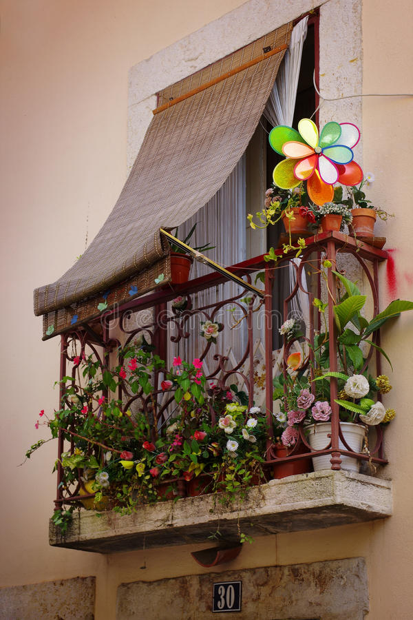 Flowery balcony. In an old neighborhood in Lisbon, Portugal stock photography