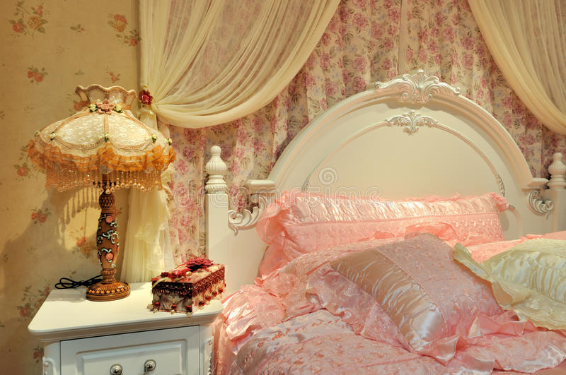 Flowery bedroom for female. Flowery and warming color bedroom interior, elegance and fine style for female stock photography