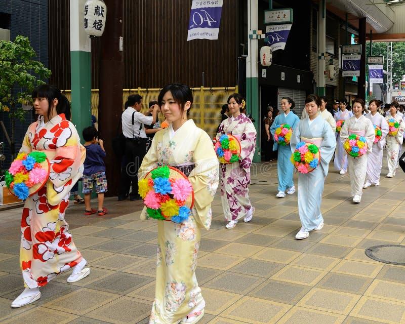 Flowery women's parade of Gion festival, Kyoto Japan. Beautiful Kimono women's parade with flowery parasols, at Gion Matsuri festival in Kyoto Japan summer. aka royalty free stock photo