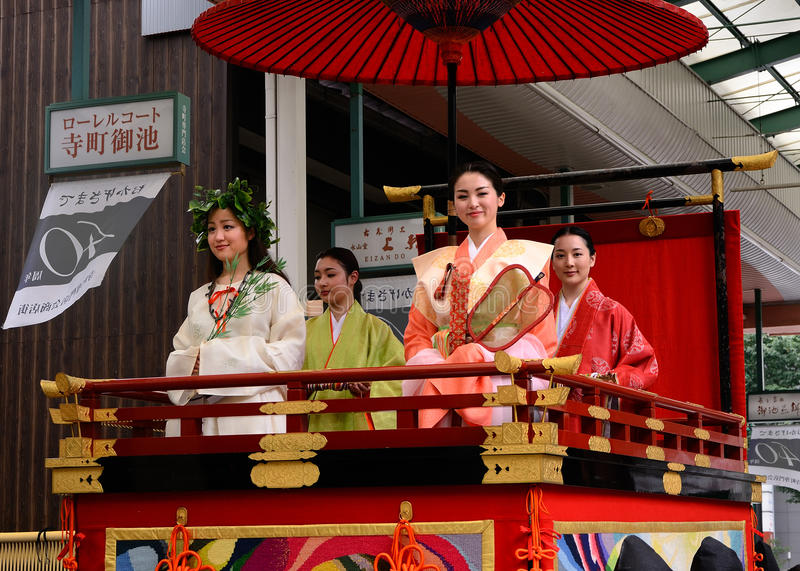 Flowery women's parade of Gion festival, Kyoto Japan. The parade of girls in authentic Kimono dresses and accessories at Gion Matsuri festival, Kyoto Japan stock photo