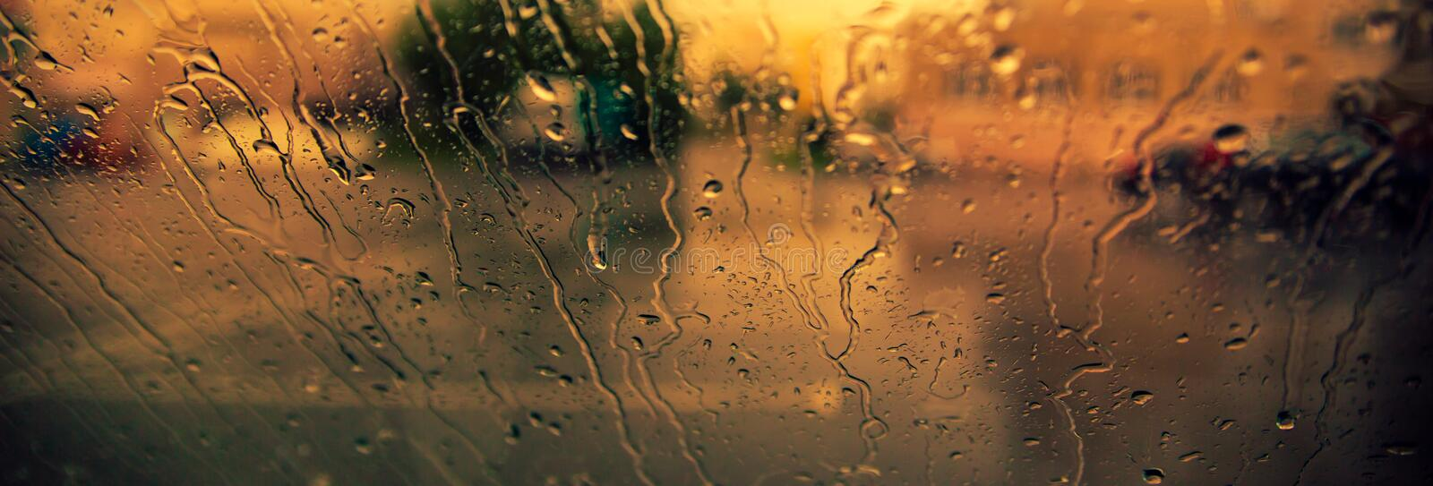 Flowing down drops of rain on car windshield. Fall concept.  royalty free stock photography