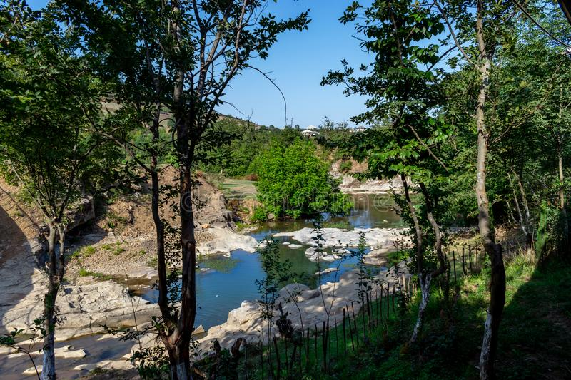 Flowing through the forest, a quiet stony and rocky river. beautiful view of nature. Azerbaijan Lerik royalty free stock image