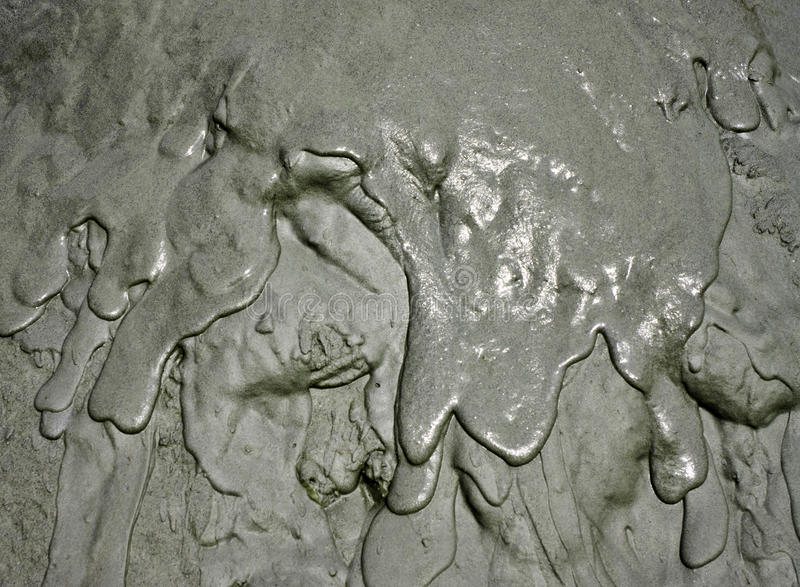 Flowing mud texture stock images