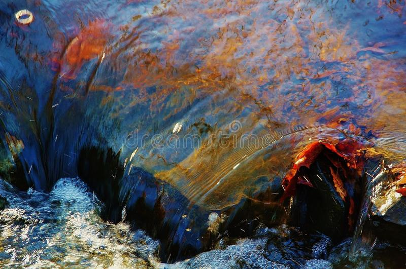 Flowing over stock image
