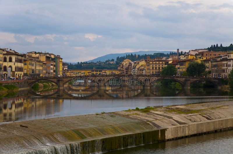 Flowing rive area flooding weir on the River Arno, Florence. Italy, Europe royalty free stock photography