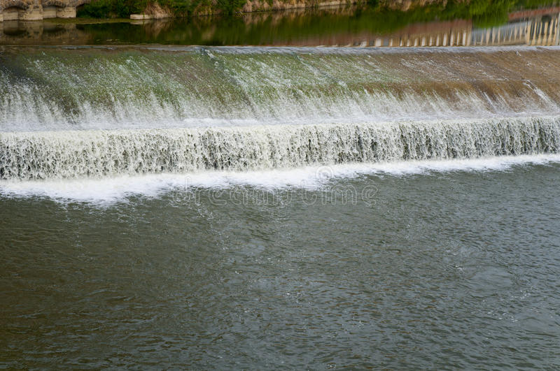 Flowing rive area flooding weir on the River Arno, Florence. Italy, Europe stock photography