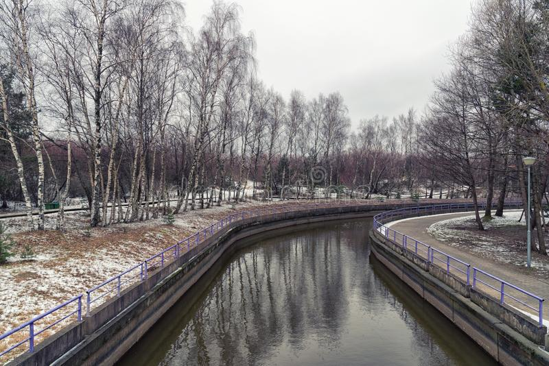 Flowing river in winter, Palanga, Lithuania royalty free stock photography
