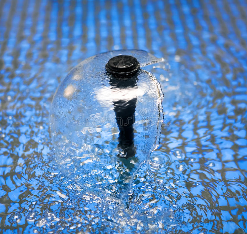 Flowing stream on water surface, fountain royalty free stock photos