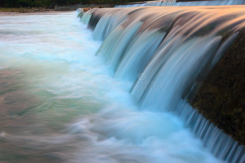 Flowing water. Abstract flowing water from a dam stock photo