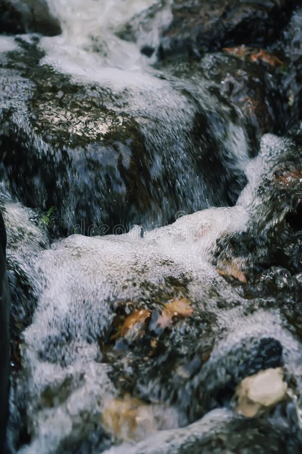 Flowing water on Bastion hill in Riga, Latvia, East Europe.  royalty free stock photography