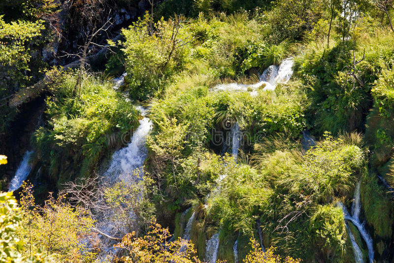 Flowing water on falling lakes of Plitvice. National Park in Croatia stock photo