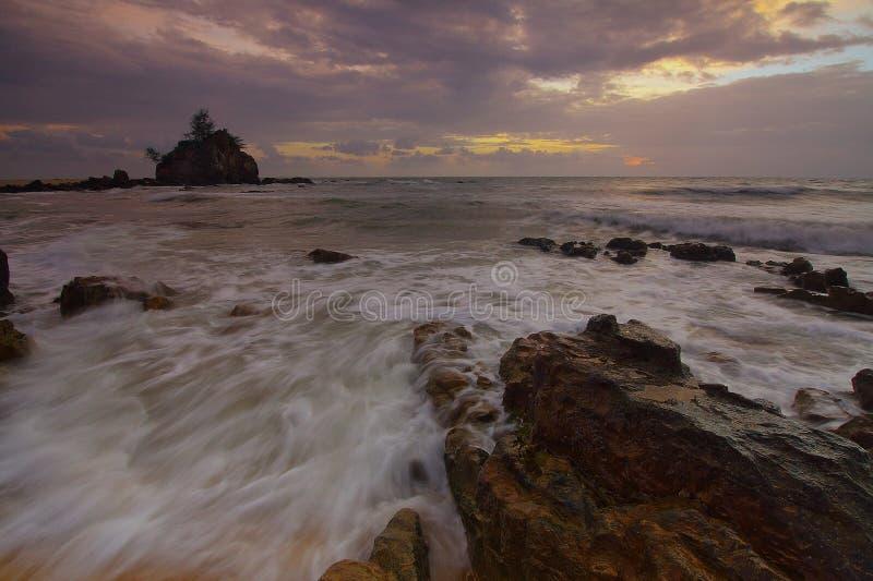 Flowing Water to the Ocean Under Grey Sky stock photo