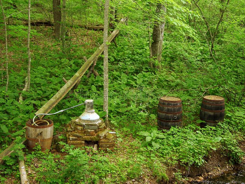 Moonshine Whiskey Still Exhibit. Floyd County, Virginia USA – May 14th: Moonshine Whiskey Still exhibit at Mabry Mill located on the Blue Ridge Parkway royalty free stock images