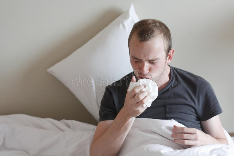 The flu. A man with the flu or a bad cold royalty free stock photos