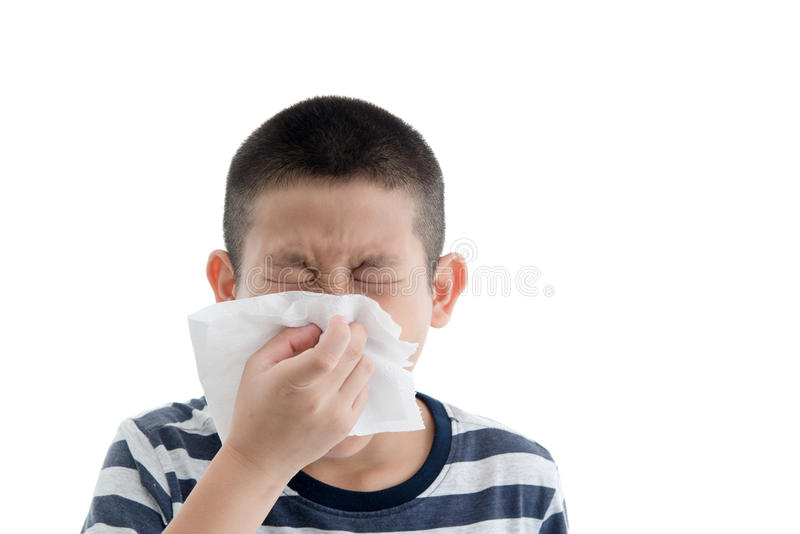 Flu cold or allergy symptom. Sick young asian boy with fever sneezing in tissue,allergies,the common cold,with blank copy space on white royalty free stock photography