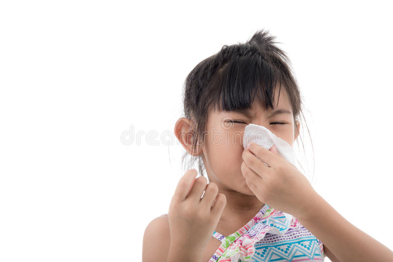 Flu cold or allergy symptom.Sick young asian. Girl with fever sneezing in tissue,allergies,the common cold,with blank copy space on white royalty free stock images
