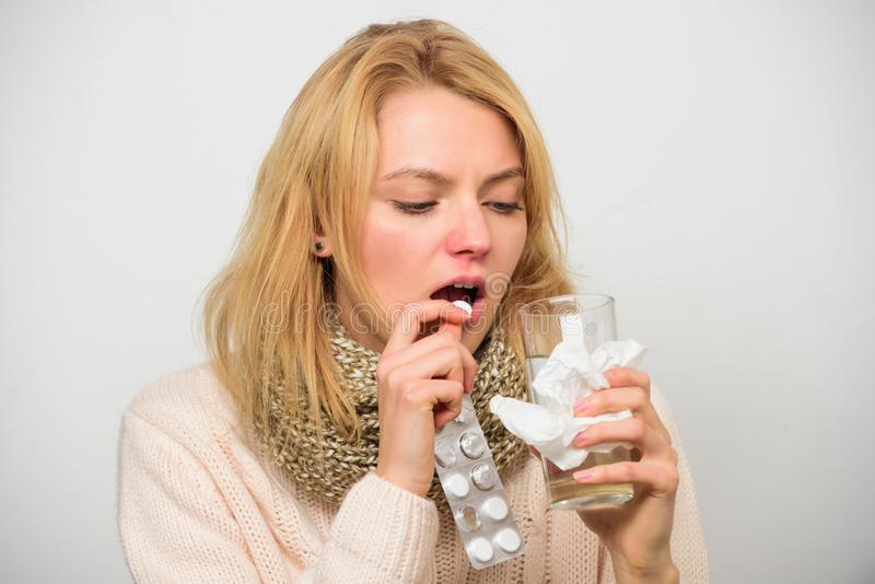 Flu and cold concept. Guidelines for treating cold. Take medications to get rid of cold. Girl take medicine drink water. Headache and cold remedies. Woman royalty free stock images