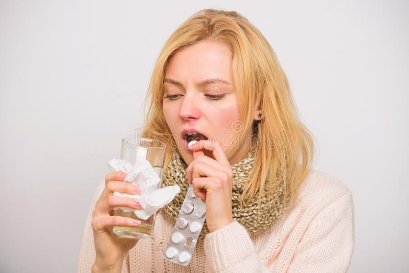 Flu and cold concept. Guidelines for treating cold. Take medications to get rid of cold. Girl take medicine drink water. Headache and cold remedies. Woman stock photo