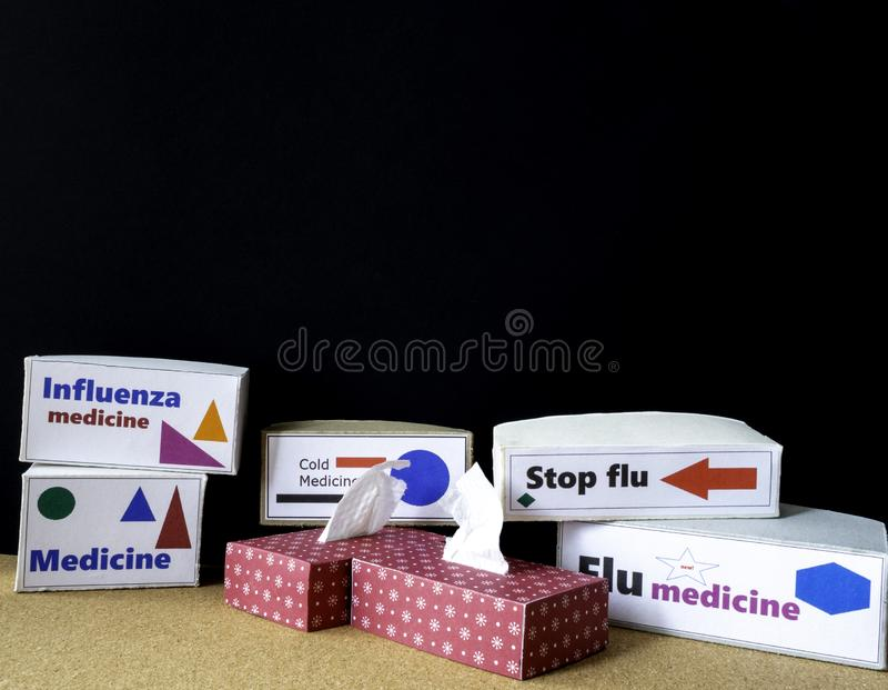 Flu and cold medicine in unbranded boxes. Tissue boxes. Room for copy. Several boxes with flu and cold medicines on a table, no brands. With two tissue boxes stock photos