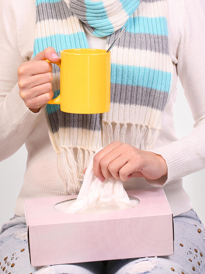 Flu cold. Sick woman with cup of tea and tissue box. Closeup royalty free stock photography
