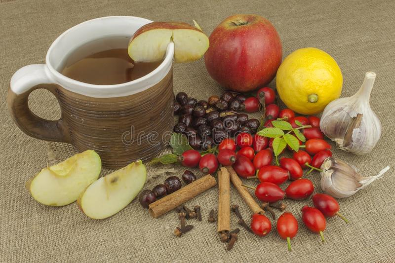 A flu epidemic. Traditional home treatment for colds and flu. Rosehip tea, honey and citrus. Hot tea with honey and lemon on a tabletop. Home Pharmacy. Proven stock images