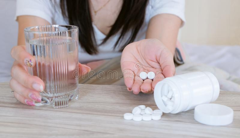 Flu medicine woman Infected With Cold the drug is placed on the table and a glass stock photography