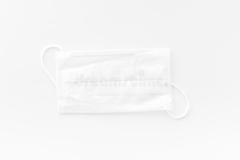 Flu prevention concept. Medical face mask on white background top view.  stock image