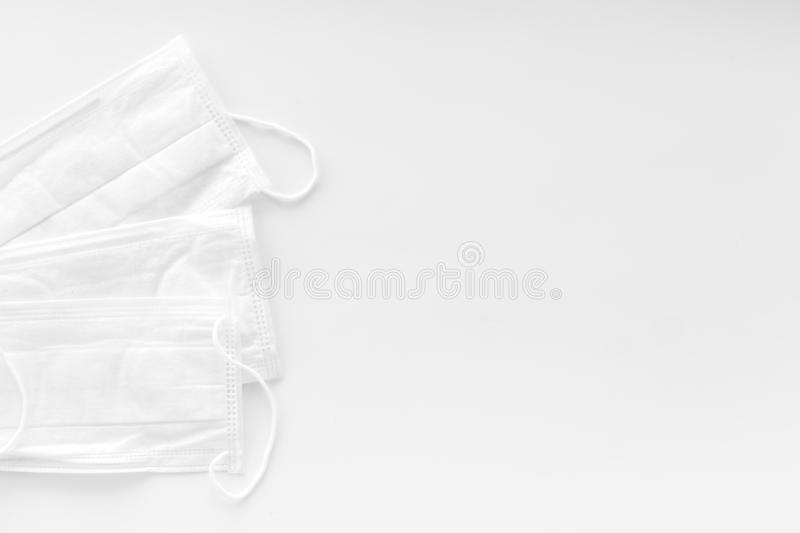 Flu prevention concept. Medical face mask on white background top view copy space. Flu prevention concept. Medical face mask on white background top view royalty free stock images