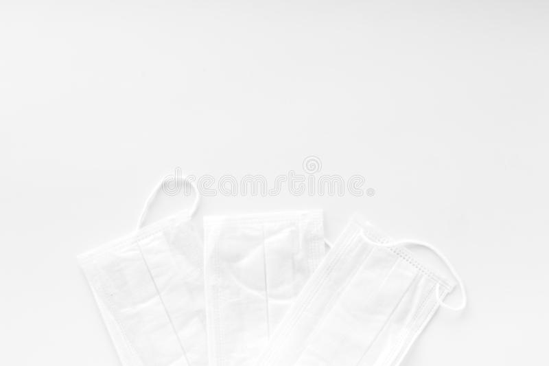 Flu prevention concept. Medical face mask on white background top view space for text. Flu prevention concept. Medical face mask on white background top view stock images