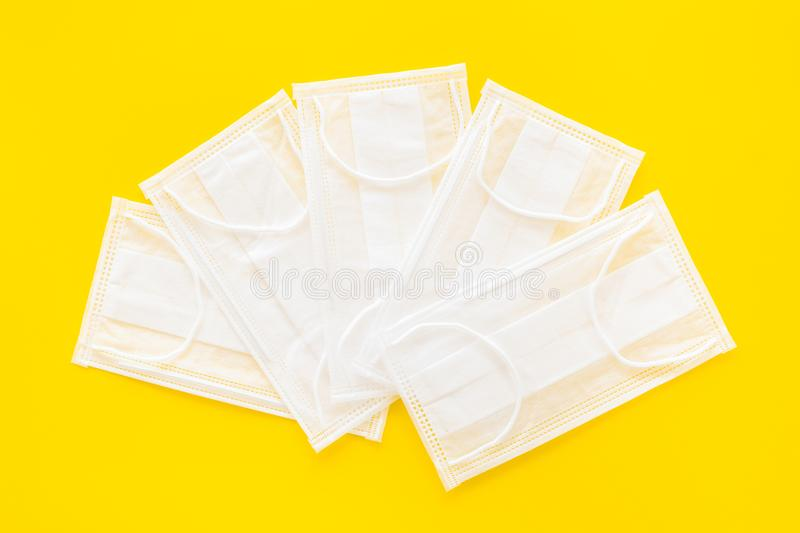 Flu prevention. Medical face masks on yellow background top view mockup. Flu prevention. Medical face masks on yellow background top view stock photography
