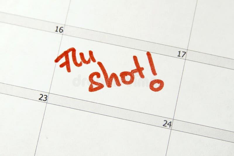 Flu shot. Calendar entry to get a flu shot stock photography