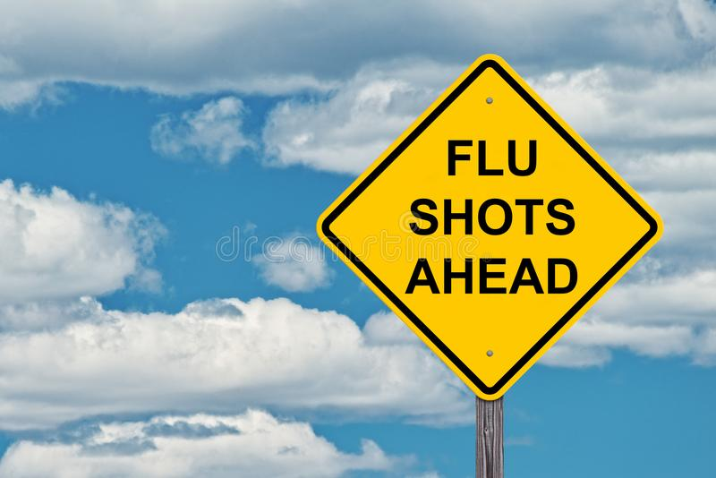 Flu Shots Ahead - Caution Sign Blue Sky royalty free stock image
