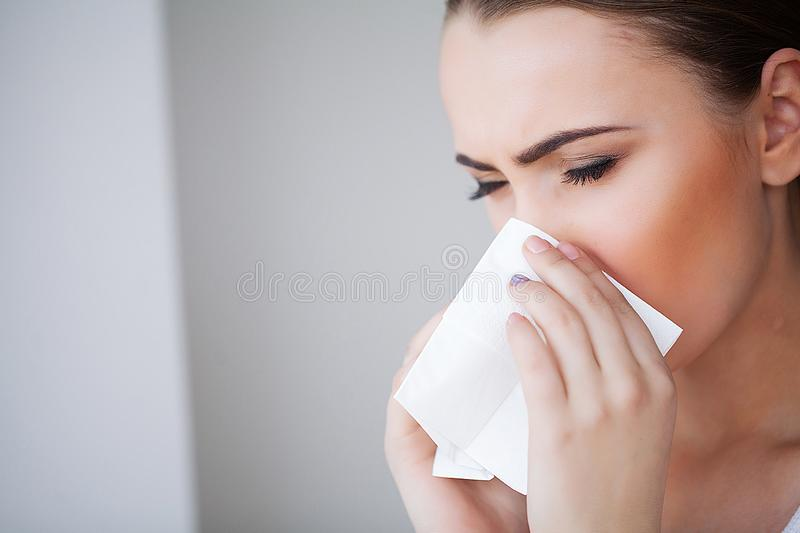 Flu and Sick Woman. Sick Woman Using Paper Tissue, Head Cold Problem.  stock images