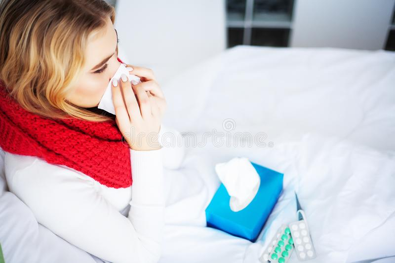 Flu and Sick Woman. Sick Woman Using Paper Tissue, Head Cold Problem.  royalty free stock photos