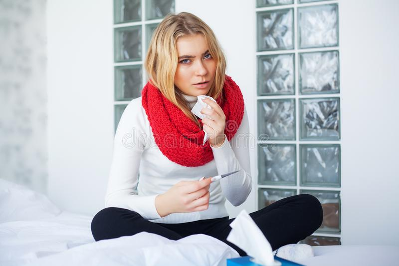 Flu and Sick Woman. Sick Woman Using Paper Tissue, Head Cold Problem.  royalty free stock photography