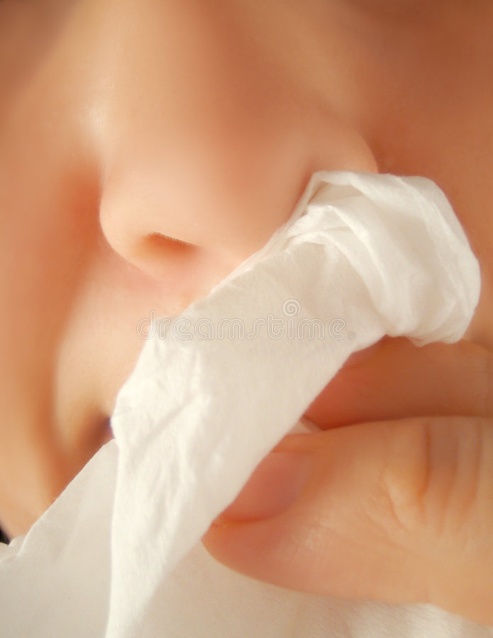 Flu sickness. Person wipes nose clean from flu sickness stock photos