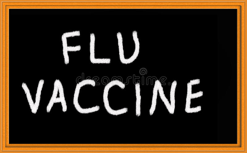 Flu vaccine. Written on chalkboard royalty free stock photography