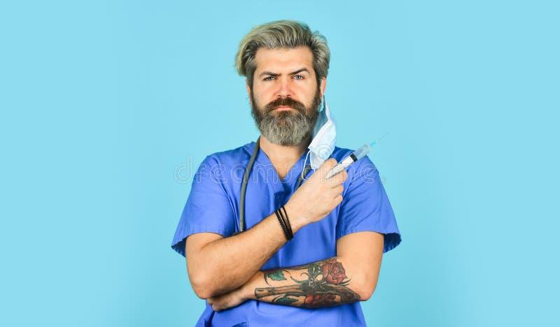Flu vaccine. Bearded doctor wear uniform use syringe needle vaccination. Antidote. Dose injection. Vaccine development. Innovation. Man nurse with coronavirus royalty free stock images