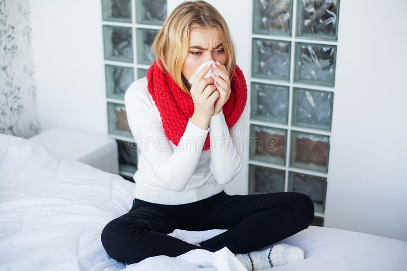 Flu. Woman Suffering From Cold Lying In Bed.  stock photography