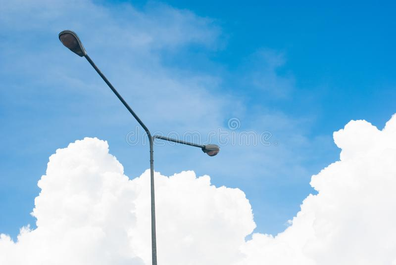 Fluffy big beautiful cloud with bright sky and light post for te royalty free stock images