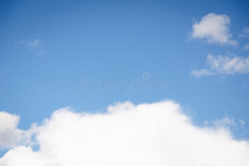 Fluffy big white cloud on the blue sky background stock photos