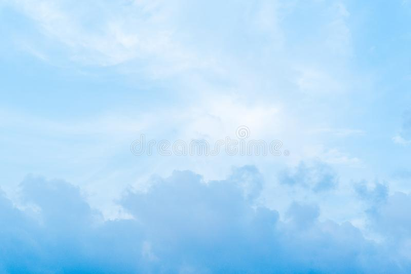 Fluffy blue sky in day light. Fluffy white clouds in blue sky in clear atmosphere rainy days royalty free stock photos